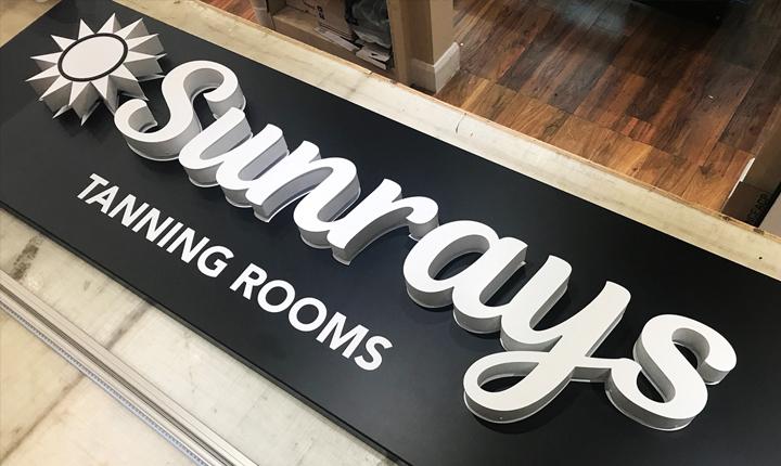 Sunrays shop signage london